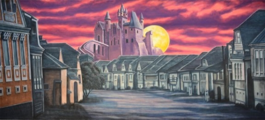 Village with scary castle backdrop is often used in productions of The Addams Family