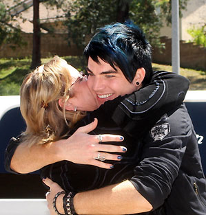 Adam Lambert gets a welcome home hug from Kathie Urban of Met2 in San Diego