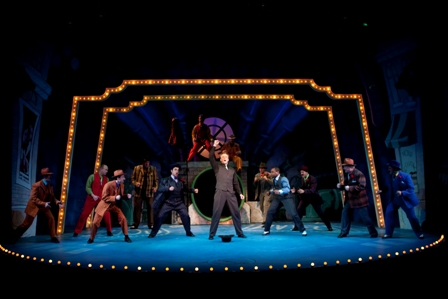 Edward Watts and the cast of GUYS & DOLLS